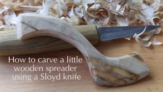 Carving a wooden spreader using a sloyd knife