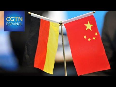 Xi Jinping y Angela Merkel abogan por el libre comercio y los mercados abiertos