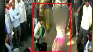 vuclip Shocking! Man thrashes wife in public following panchayat's diktat
