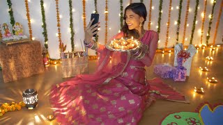 Pretty Indian lady enjoying while taking selfies with burning Diyas on Diwali festival