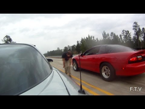 Two built 500+ hp 4th gen camaros battle heads up on the street.