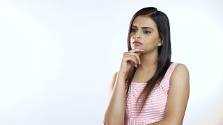 Serious young Indian woman thinking hard and expressing her confusion - emotion concept