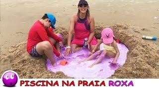 PISCINA GIGANTE NA AREIA DA PRAIA COM CORANTE E ESPUMA ROXA