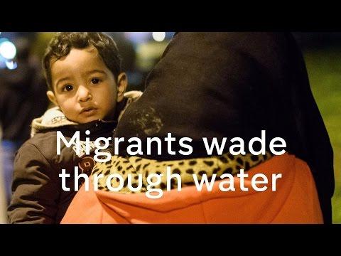 European migrant crisis: refugees wade through freezing water into Slovenia