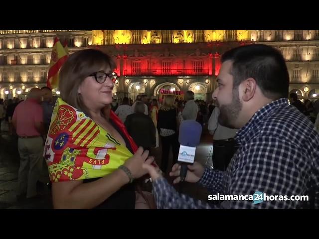 Hablan los asistentes al encendido de la Plaza Mayor con los colores de la bandera española