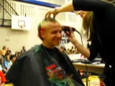 Zack having his head shaved at Mountain Park School