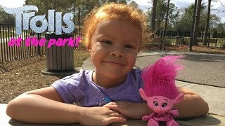 Little girl plays with troll