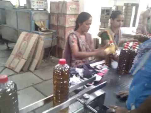 Pet Bottle oil Filling and capping machine , Mustard oil filling machine , Edible oil filling line