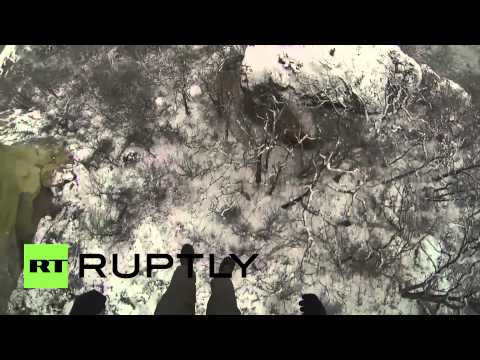 Russia: Daredevil jumps off cliff with HOOKS in his back