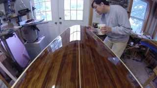 Applying Varnish For A Smooth, Reflective Finish On A Strip Built Boat