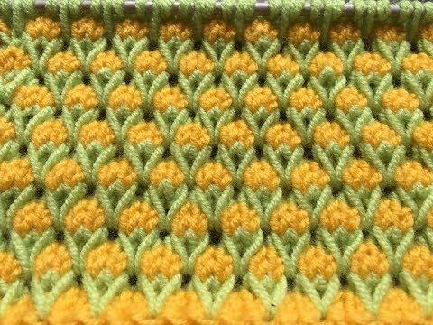 Двухцветные узоры из снятых петель спицами