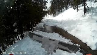 Snowcat ride through deep snow and washouts