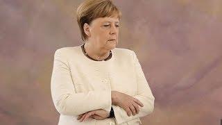 Angela Merkel seen shaking for second time