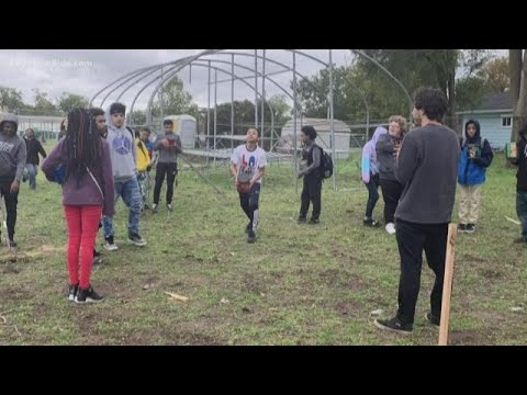 Students from Michigan State University are helping Muskegon Middle School students build a greenhou