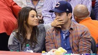 Mila Kunis and Ashton Kutcher Celebrate Their Pregnancy on the Kiss Cam!