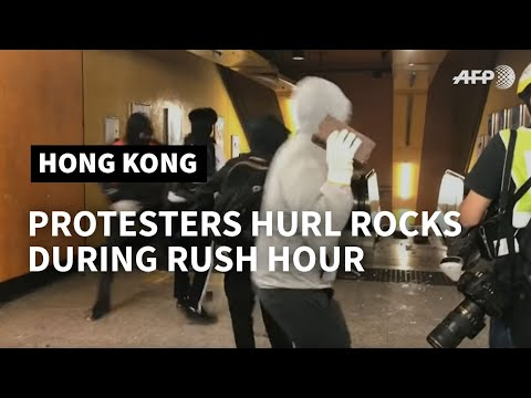 Hong Kong protesters throw bricks inside metro station | AFP