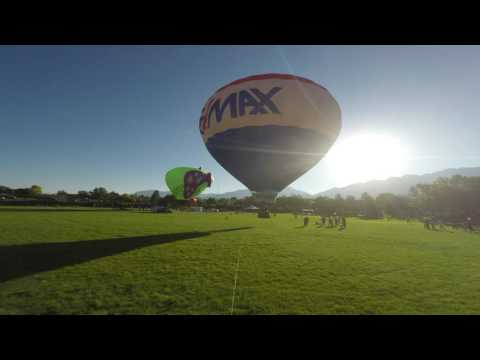 Sunrise and Balloons rise in the Wasatch Range