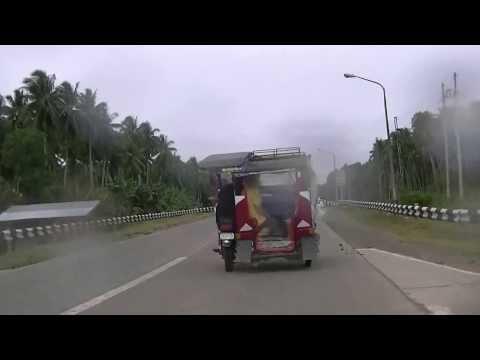 Life in the Philippines..Biking in the Rain.Mindano