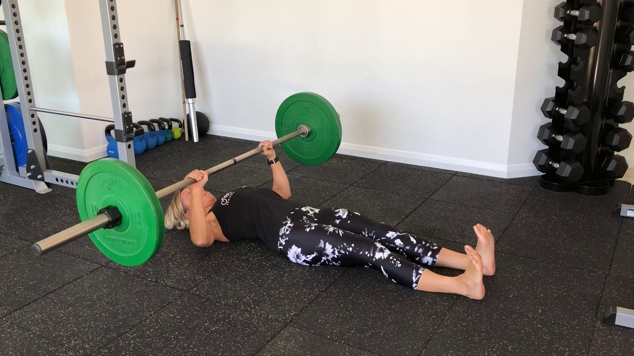 Barbell floor press without a rack