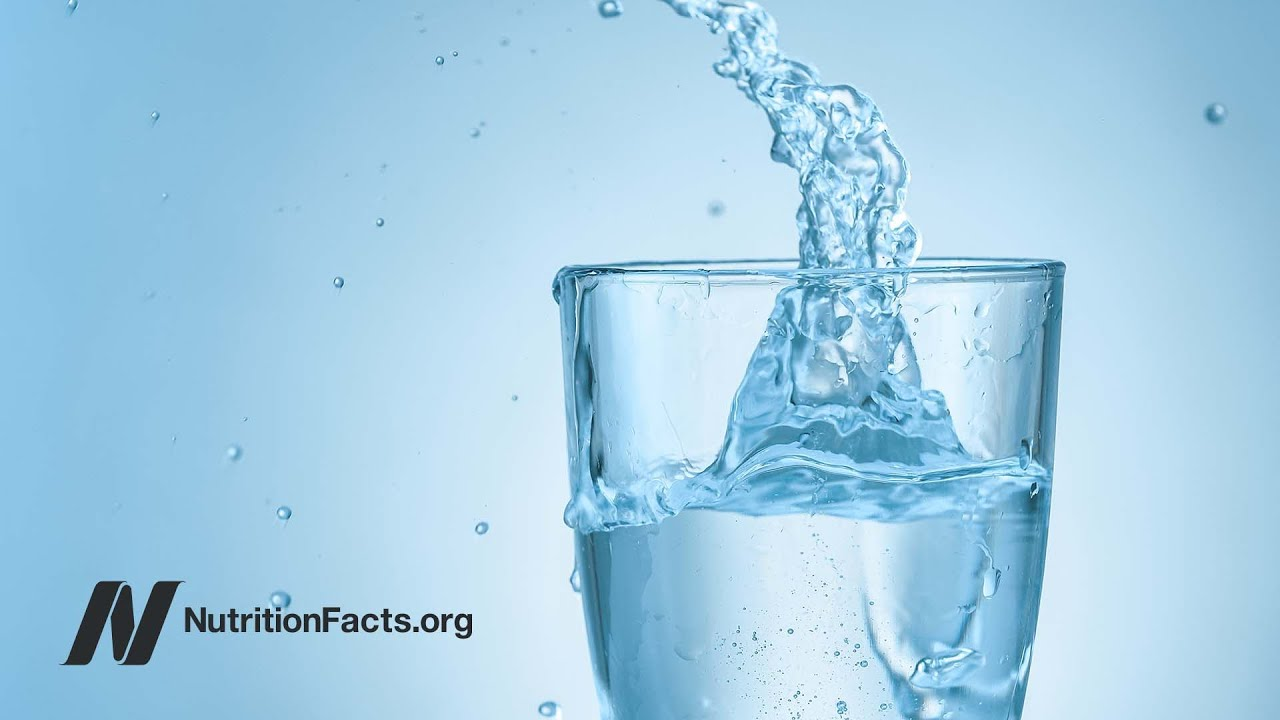 Child Drinking Cup Of Water