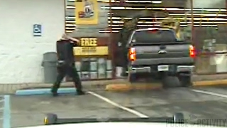 Police Dashcam Captures Truck Crashing Through Auto Parts Store