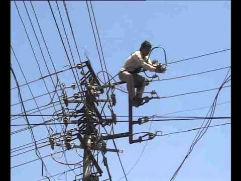 New Delhi Man on Power Cables - Christian Kyriacou