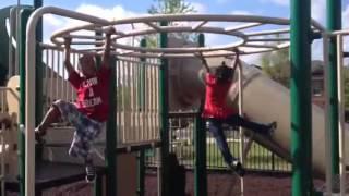 Kids being kids racing on the monkey bars