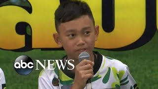 The 12 young soccer players and their coach made their first public...