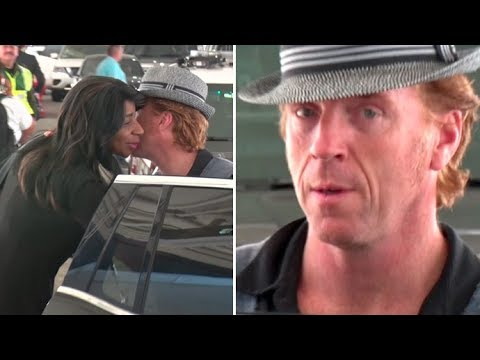 EXCLUSIVE - 'Homeland' Star Damian Lewis Gives His Airport Greeter A Kiss Upon Arrival In L.A.