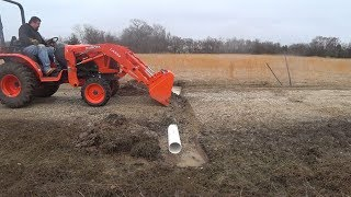 Ep. 33 - Installing a Culvert Pipe Under the Driveway with the Kubota B2650 and Rhino Box Blade