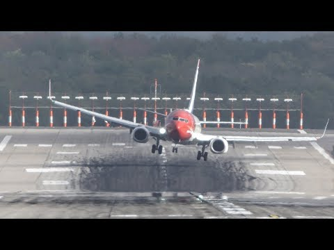 "CROSSWIND LANDINGS during storm ""Herwart"" at Düsseldorf with a GO AROUND and a BOEING 747 (4K)"