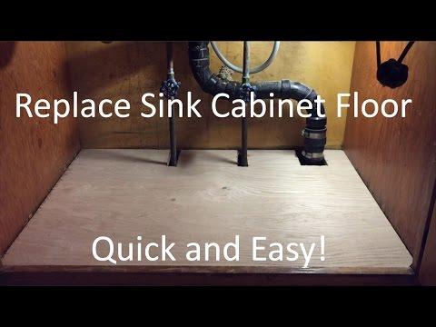 Replacing a sink base cabinet bottom floor after water leak damage ...