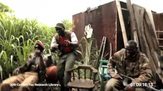 A monkey shoot AK-47 machine gun in a group of soldiers who laughed at it