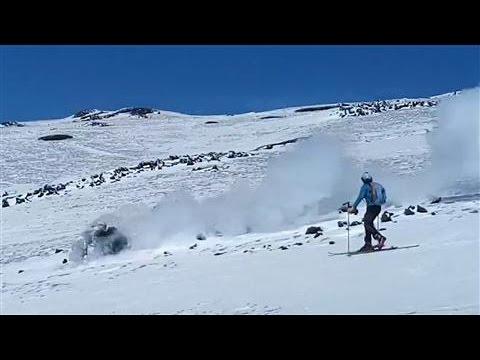 Mount Etna Eruption: Skiers Chase Smoldering Boulder