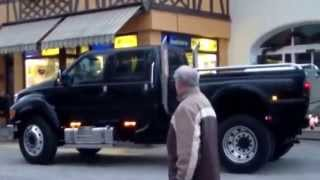 Ford F 650 in city really big suv car 4x4 huge