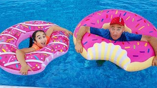 Gamze play with large inflatable donut in the pool, funny kid video