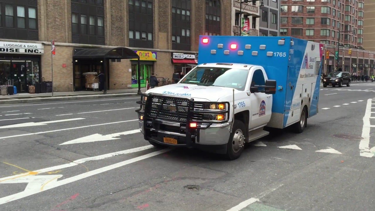MOUNT SINAI WEST EMS AMBULANCE RESPONDING ON 8TH AVENUE IN MIDTOWN,  MANHATTAN IN NEW YORK CITY