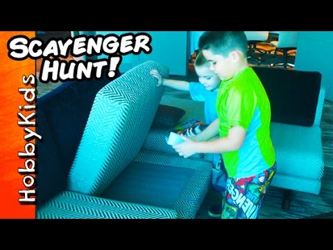Biggest Hotel SCAVENGER HUNT! Superhero Hotel Room Toys Hiding in our Room HobbyKidsTV