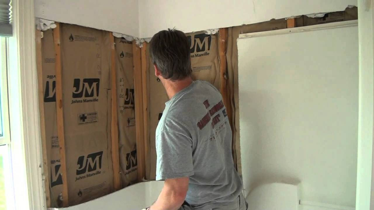 bathroom remodel removing a fiberglass shower