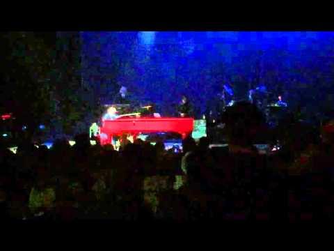 "Elton John's improvised intro to ""Rocket Man"", including fragments of ""Space Oddity"""