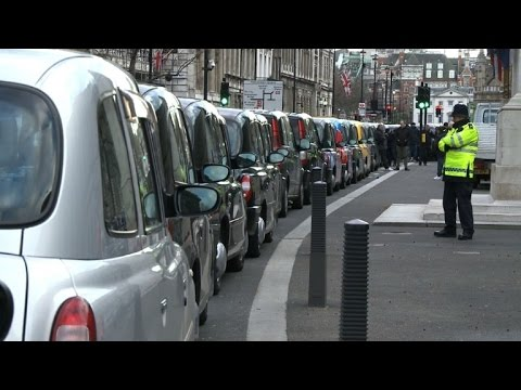 London black cab drivers block streets in Uber demo