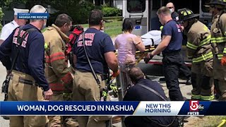 Woman and dog rescued from manhole in Nashua after neighbors hear cries for help