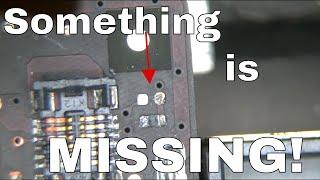 Macbook Pro logic board not charging battery, missing pullup resistor on SMC data line.