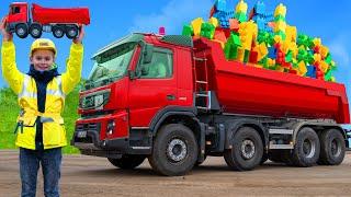 Çocuklar kamyonlar, ekskavatörler, oyuncaklarla öğrenir ve oynar Trucks and toys for kids