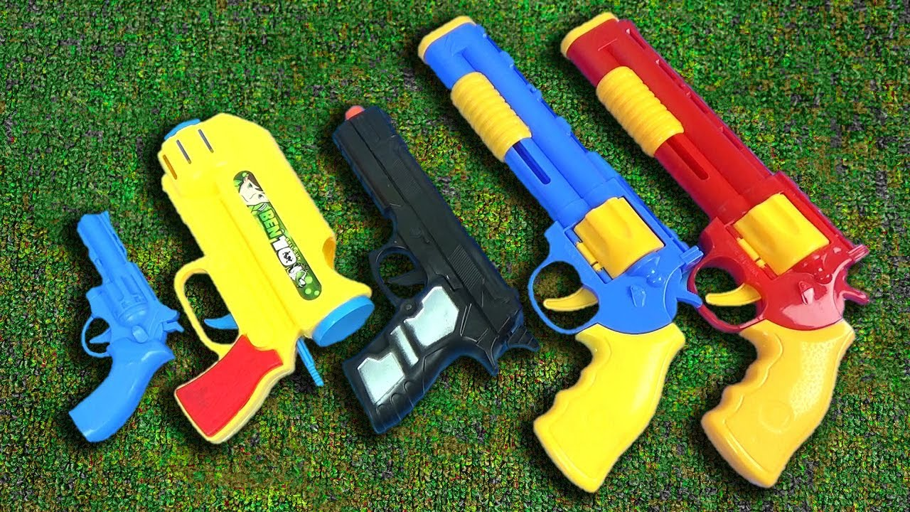 Box Of Toys With 5 Colorful Toys Colored Toy Guns