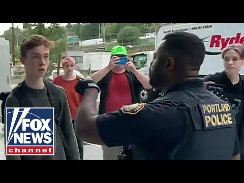 Antifa caught on camera harassing police at climate change rally
