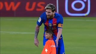 Lionel messi walked out onto the pitch ahead of barcelona's match against al-ahli saudi fc with a very special mascot; murtaza ahmadi. young afghan boy g...