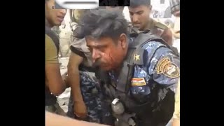 An officer in the Iraqi Federal Police, mortally how he survived from a large group of snipers lsls