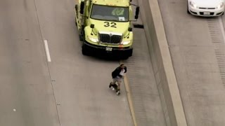 Illinois state Police and IDOT Tow truck drivers  tackle man On the Dan Ryan  after he falls