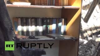 Ukraine: Kiev prisoners of war reconstruct destroyed Donetsk school